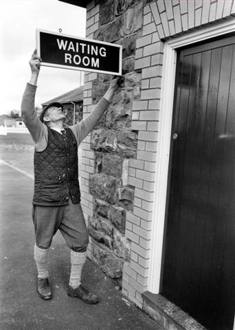 John Keylock erects the Waiting Room sign